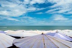 Large umbrella crowded along Cha-Am beach Royalty Free Stock Image