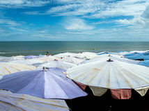 Large umbrella crowded along Cha-Am beach Royalty Free Stock Photography