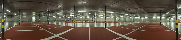Large underground parking, panoramic view Royalty Free Stock Photo