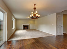 Large unfurnished living room with fireplace. Stock Photography