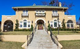 Large upscale adobe home with steps leading up to it decorated for Christmas. With wreaths and garlands Stock Photo