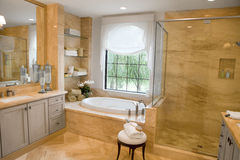 Large Upscale Master Bathroom Stock Photo