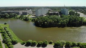 Large urban pond in Victory Park in Zelenograd in Moscow, Russia. A large urban pond in Victory Park in Zelenograd in Moscow, Russia stock video