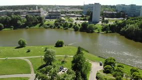 Large urban pond in Victory Park in Zelenograd in Moscow, Russia. A large urban pond in Victory Park in Zelenograd in Moscow, Russia stock footage