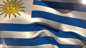 Large uruguay national flag waving. With lens flare stock footage