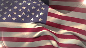 Large usa national flag waving. With lens flare stock footage