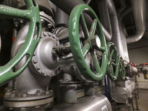 Large valves with a green knob in the installation of cold water Stock Photos