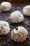 Large vanilla marshmallows. Sweet dessert - large vanilla marshmallows  on a wooden table with coffee beans, selective focus Royalty Free Stock Image