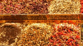 Large variety of spice and tea on the counter of the Arab or Turkish market. A large variety of spice and tea on the counter of the Arab or Turkish market stock footage