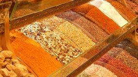 Large variety of spice and tea on the counter of the Arab or Turkish market. A large variety of spice and tea on the counter of the Arab or Turkish market stock video footage