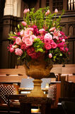 Large vase of Wedding flowers in a church Royalty Free Stock Images