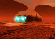 Large vehicle driving on the surface of Mars Stock Photography