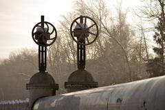 Large vertical valve, valve on the pipeline. Industrial valve in a large system. Russia stock images