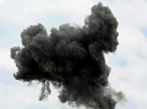 large very dense black cloud of the explosion Stock Photography