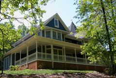 Large Victorian Home. Large Victorian style home on a hill royalty free stock photo