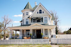 Large Victorian Style Home. Large three-story Victorian style home with a white picket fence Royalty Free Stock Images