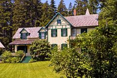 Large Victorian summer cottage. A view of an old, large summer cottage in the Maine woods, built in an old Victorian style Royalty Free Stock Photo