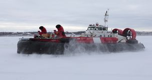 Hovercraft operating on ice. Large view of hovercraft operating on ice in winter condition stock video
