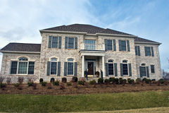 Large Virginia Home. Large brick home in Northern Virginia during early to mid-winter stock images