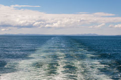 Large wake on open ocean left by a large ferry boat Royalty Free Stock Image