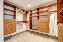 Large walk in closet with carpet floor. stock images