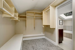 Large walk-in closet with carpet. Stock Photography
