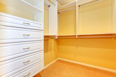 Large walk in Closet with shelve system. Royalty Free Stock Photography
