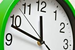Large, wall, analog clock isolated on white background Stock Photography