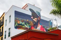 Free Large Wall Art Of Man With Baseball Hat On Building In Puerto De La Cruz, Tenerife, Spain Royalty Free Stock Photo - 127473815