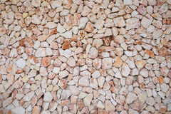 Large wall of brown and pink colored stones Royalty Free Stock Image