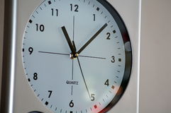 Large Wall Clock. A large round clock hanging on the wall Royalty Free Stock Photo