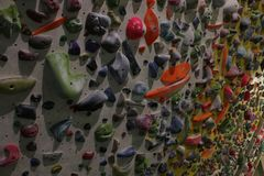 Large wall full of grips to climb up during a bouldering session stock photos
