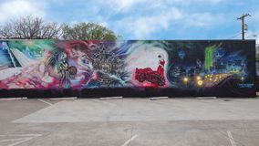 Large wall mural by Josh Mittag in Dallas, Texas. Pictured is a large wall mural along a parking lot in Dallas, Texas.  It was painted by Josh Mittag, well known Stock Images