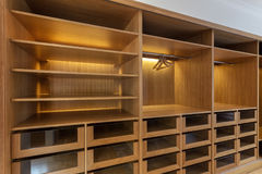 Large wardrobe closet, with empty shelves. In house royalty free stock photos