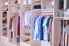 Large wardrobe with clothes and shoes. Large wardrobe with different clothes and shoes royalty free stock photography
