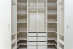 Large wardrobe locker for clothes. White vertical Stock Photo