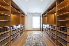 Large wardrobe room, with empty shelves. Royalty Free Stock Photo
