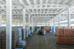 Large warehouse with drinks. Panoramic view of a large warehouse with drinks in plastic bottles with loading machines Stock Photography