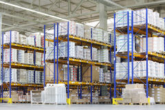 Large warehouse with lots of tall shelves Royalty Free Stock Photo
