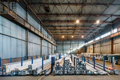 Large warehouse metal profile and metal. Packs of steel pipes are laid in the racks stock image