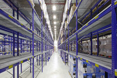Large warehouse. Large modern warehouse with plumbing, wrapped in foil on wooden pallets Stock Photos