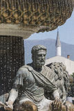 Large water fountain and bronze sculptures of adults and childre Royalty Free Stock Images