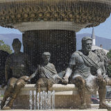 Large water fountain and bronze sculptures of adults and childre Stock Image