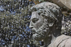 Large water fountain and bronze sculptures of adults and childre Stock Images