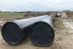 Large water pipes / gas pipes / oil pipes. Laying the water supply between the cities. Pipes lie on the ground ready for royalty free stock photos