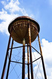 A large water tank and a bright sky Royalty Free Stock Image
