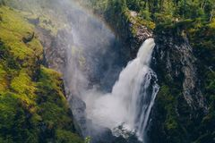 Large waterfall falling into a deep ravine in the woods. Hällingsåfallet, Sweden Stock Images