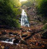 Large waterfall in the forest stock photography