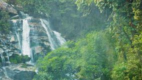 Large waterfall in the jungle near Chiang Rai, Thailand stock video