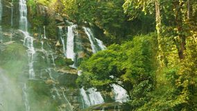 Large waterfall near Chiang Rai, Thailand. Vertical pan Royalty Free Stock Image